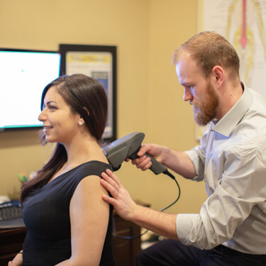 Doctor with chiropractic patient