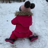 Child sitting in snow