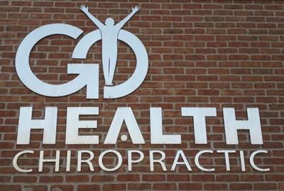 Go Health Chiropractic logo on wall