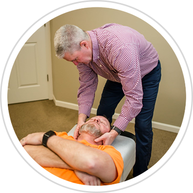 Dr. Hiatt adjusting patient