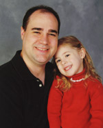 Chiropractor in North Raleigh, Dr. Randy Murray and his daughter.