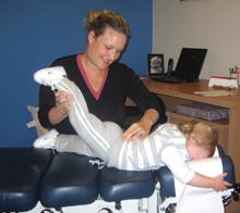 Dr Gillian Nixon doing a spinal assessment