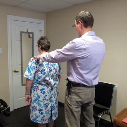 Dr. Martin examining patients back