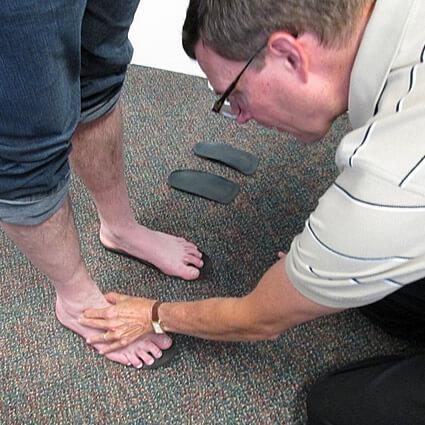 Dr. Martin examining feet