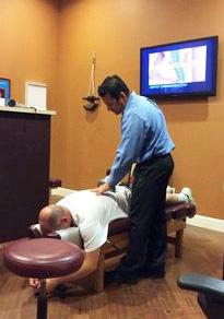 corona chiropractor dr vic ortiz adjusts