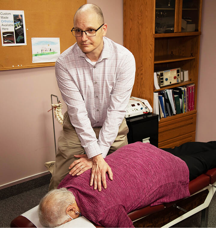 Dr. Robichaud adjusting patient