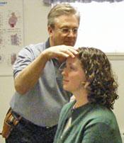 Dr. Fedon adjusts a patient.
