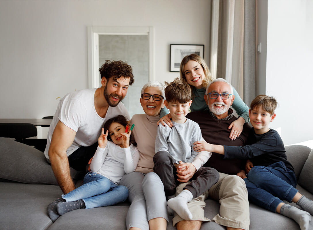multigeneration family sitting on couch