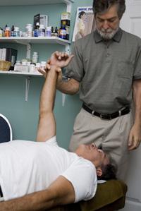 Dr. Philip Hurd adjusts a patient at {PRACTICE NAME} in {PJ}