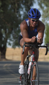 Dr. Hoffart competing in cyclist competition.