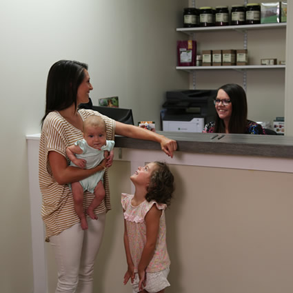 Family at reception desk
