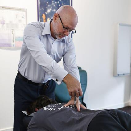 Dr. Sandy adjusting with activator