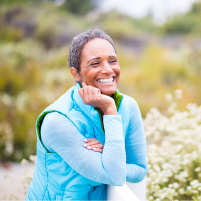 older active woman smiling outdoors