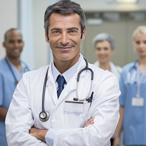 Medical doctor and staff at the background