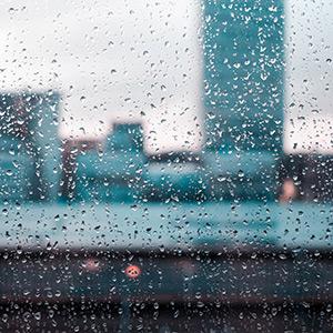Rainy window on a stormy day