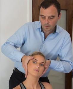 Chiropractor adjusting patients neck