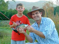 Dr. Parker Adams fishing with his son