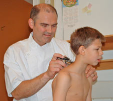 The doctor treating a patient