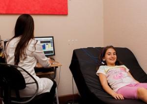 girl receiving biofeedback treatment