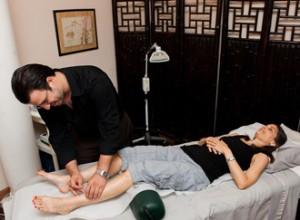 Dr. Agoado gives acupuncture treatment