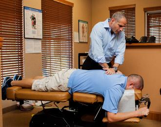 Dr. Joe adjusting at Parkside Health & Wellness Center