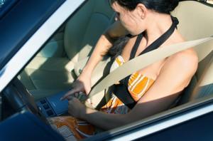 woman buckling seat belt