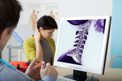 Doctor explaining x-rays to patient