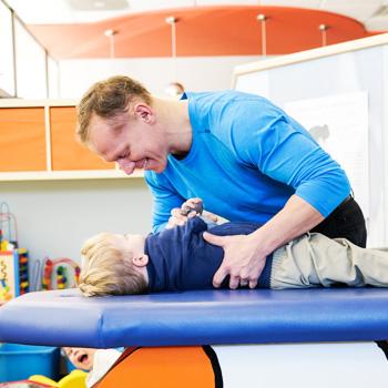 chiropractor-adjusting-child