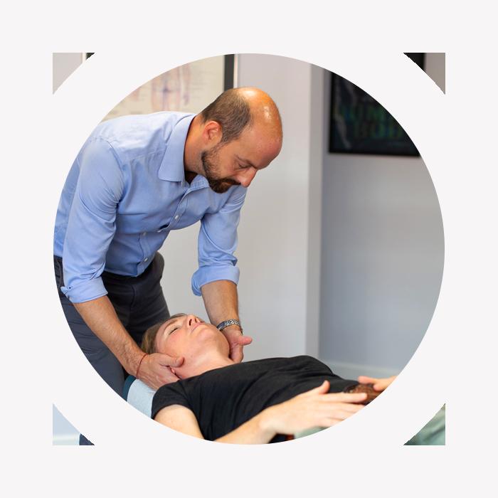 Dr Colliver adjusting patient