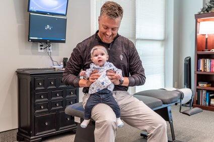Dr. Matt holding baby