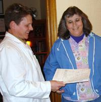 Dr holding paperwork