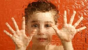 Boy behind glass