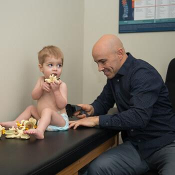 Dr. Jeremy scanning child
