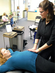 expectant mother being adjusted by Dr. Curran.