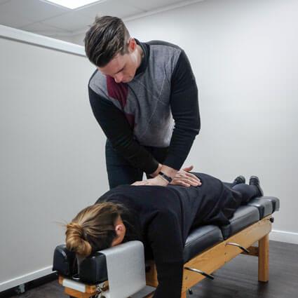 Chiropractic adjustment of back