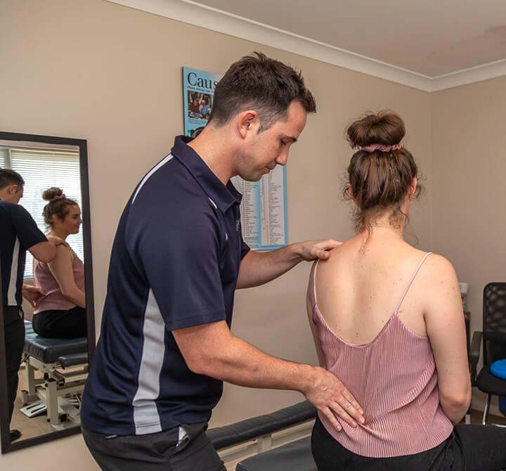 Dr David Brown, Chiropractor examining patient