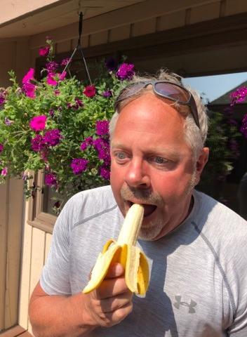 Ken eating banana