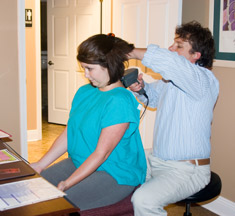 Dr. Payne performing an infra-red scan of the spine.