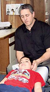 Dr. Karas adjusting a patient.