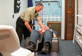 Chiropractor adjusting a patients leg