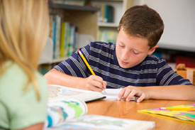 Child concentrating on class work