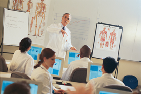 Medical instructor with students in classroom