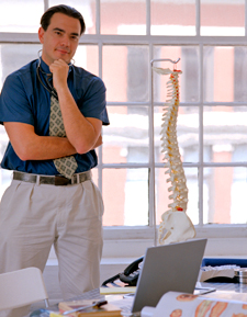 Chiropractor in his office