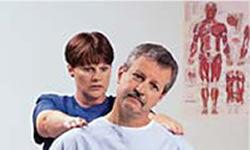 Chiropractor examining a patient