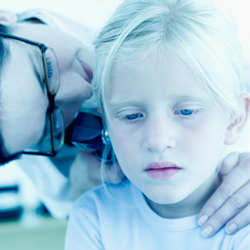 doctor checking child's ear
