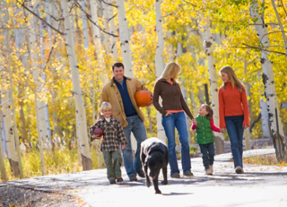 Family taking a fall walk