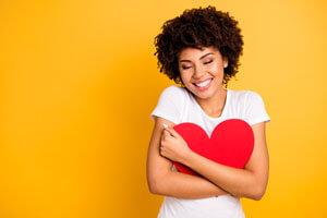 Woman hugging heart