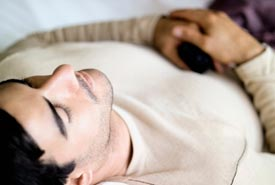 Man lying on Intersegmental Traction table