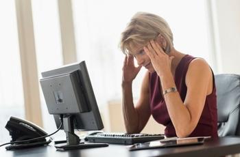 Woman looking at computer screen.