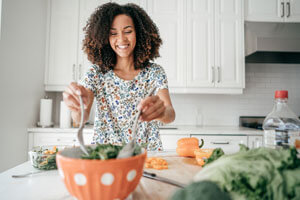 woman making salad